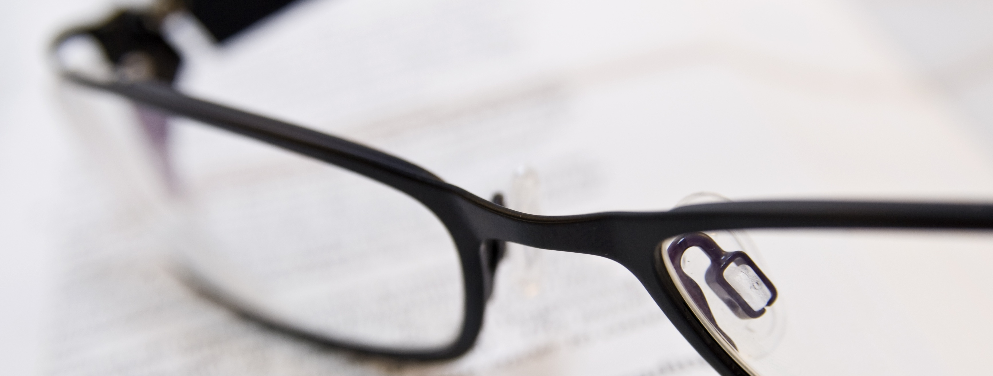 Reading glasses as a symbol for proofreading services