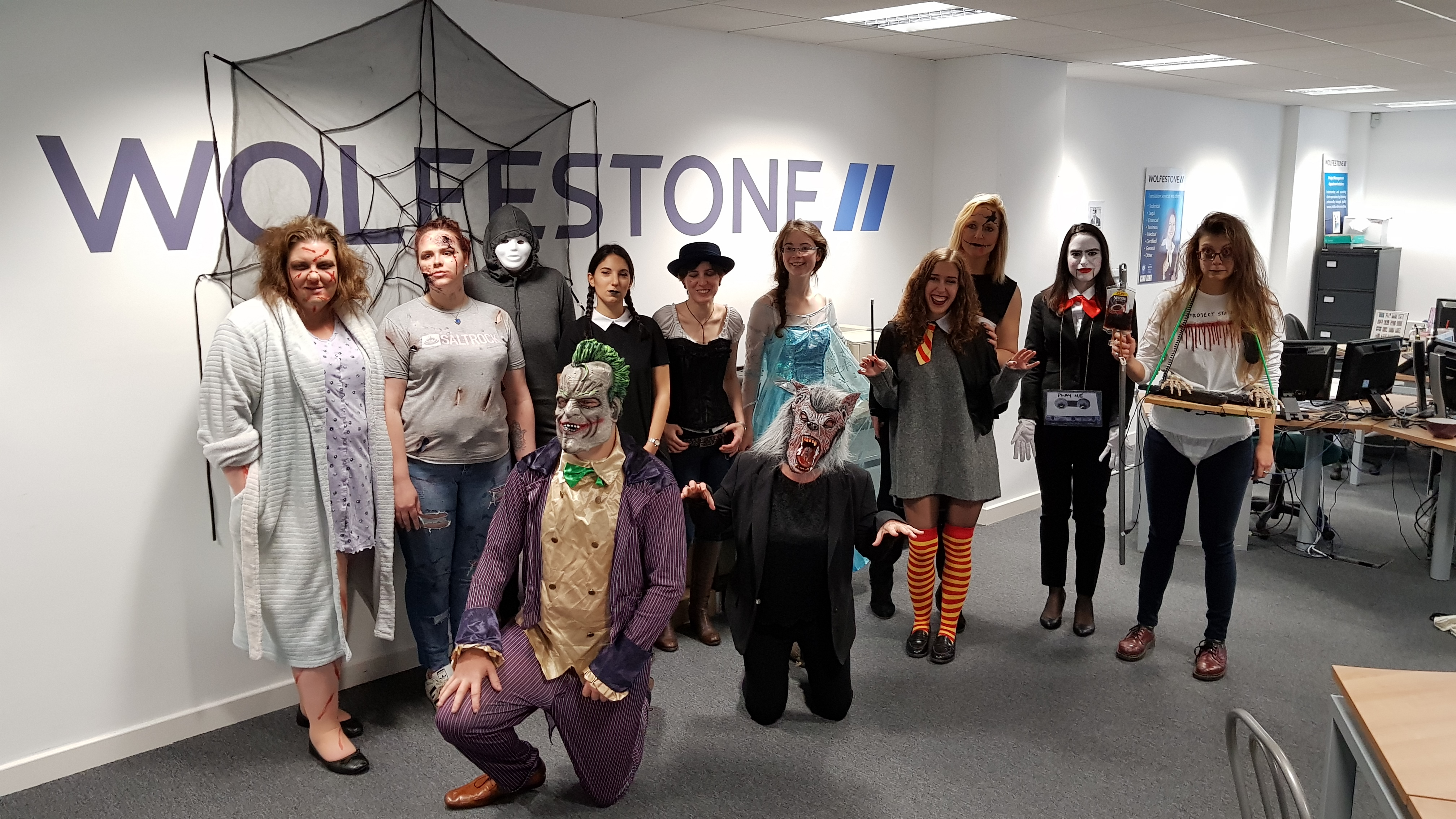 Photograph of Wolfestone employees in their Halloween costumes.