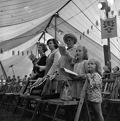 Image of family singing at the 1968 Eisteddfod in Llanrwst