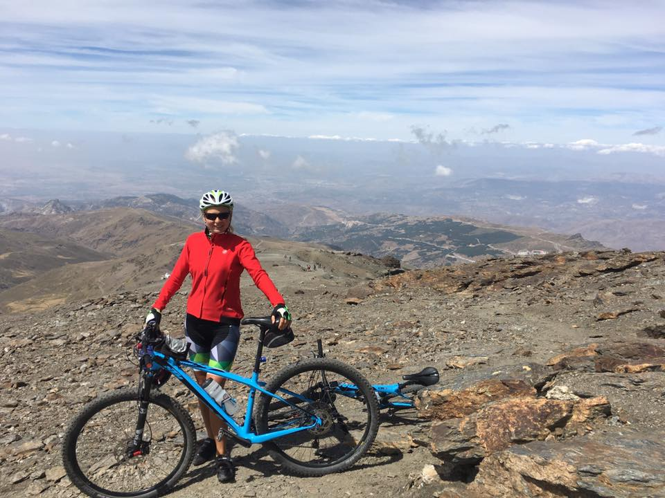 Anna with bike in Spanish mountains.