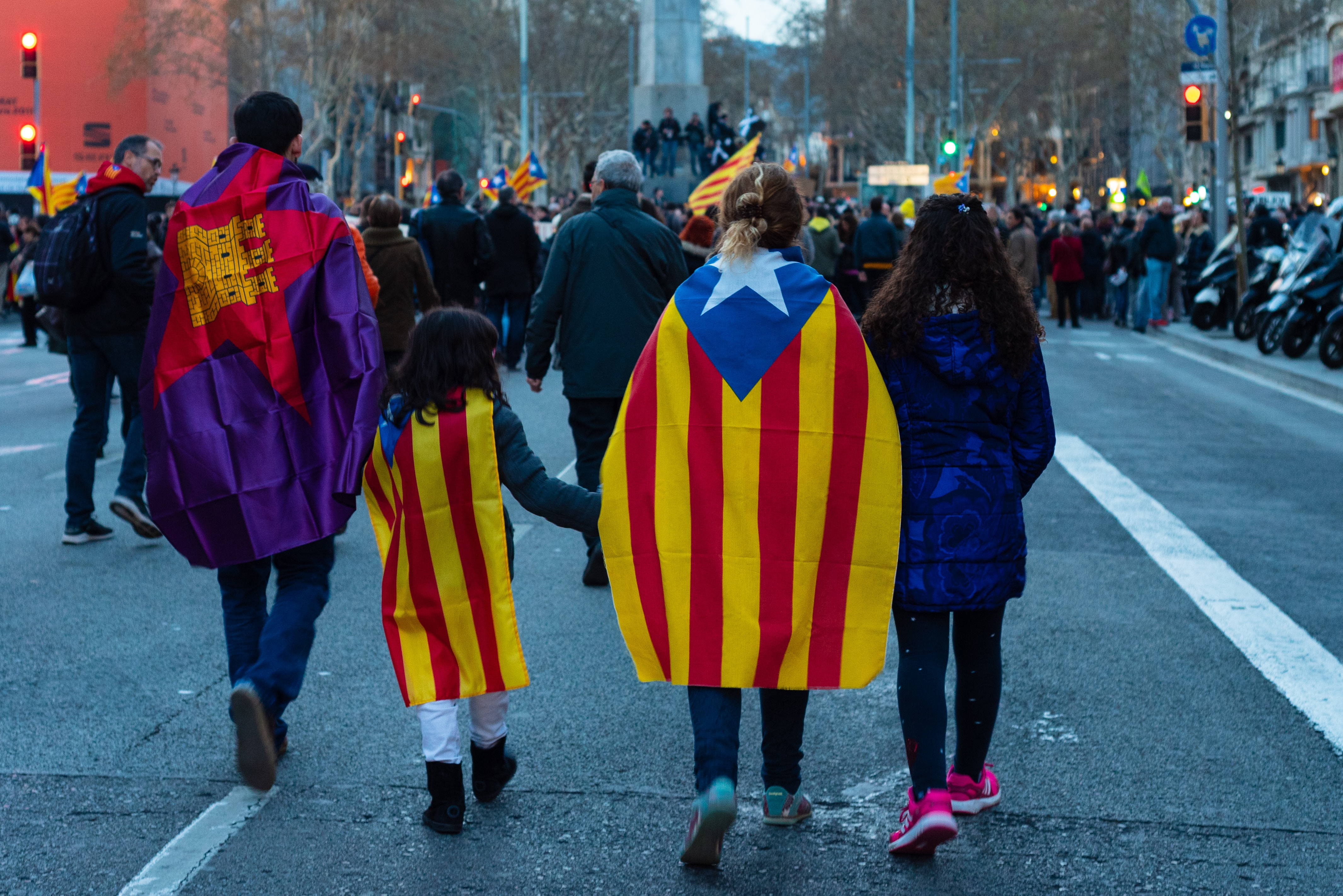 Family wearing Catalan flags
