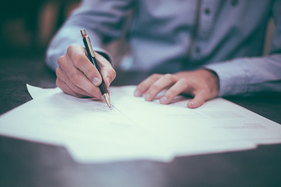 Gentleman signing a legal contract for international mergers and acquisitions