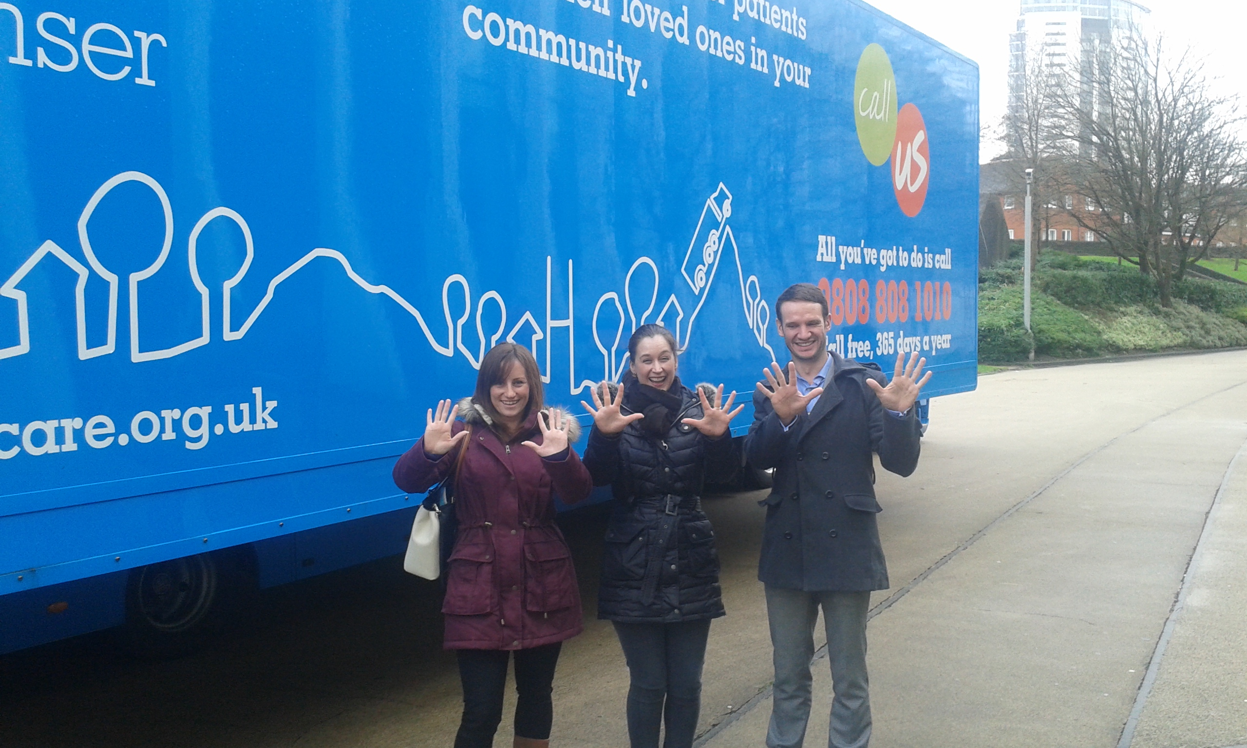 Emma, Roy and Sara in front of the Tenovus bus