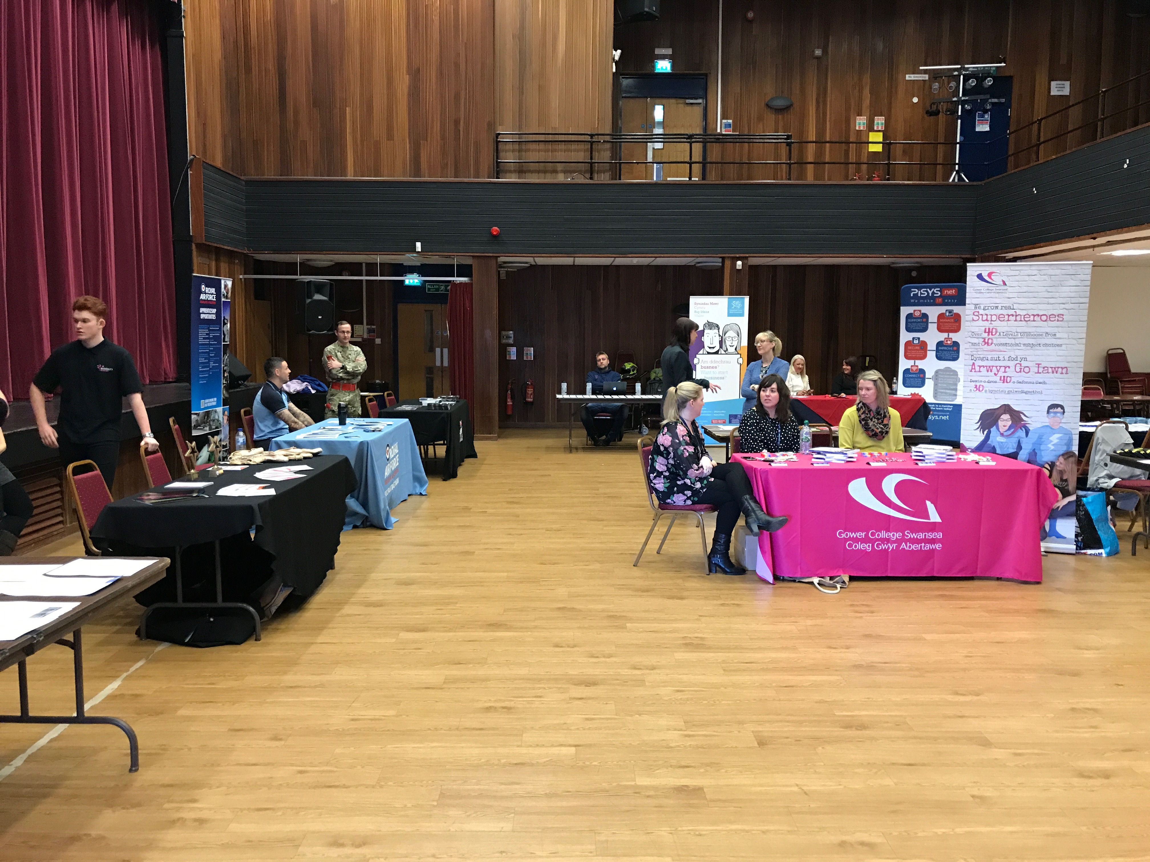 An image taken from Penyrheol Comprehensive School's Careers Fair. Image includes stalls from Gower College and other local businesses.