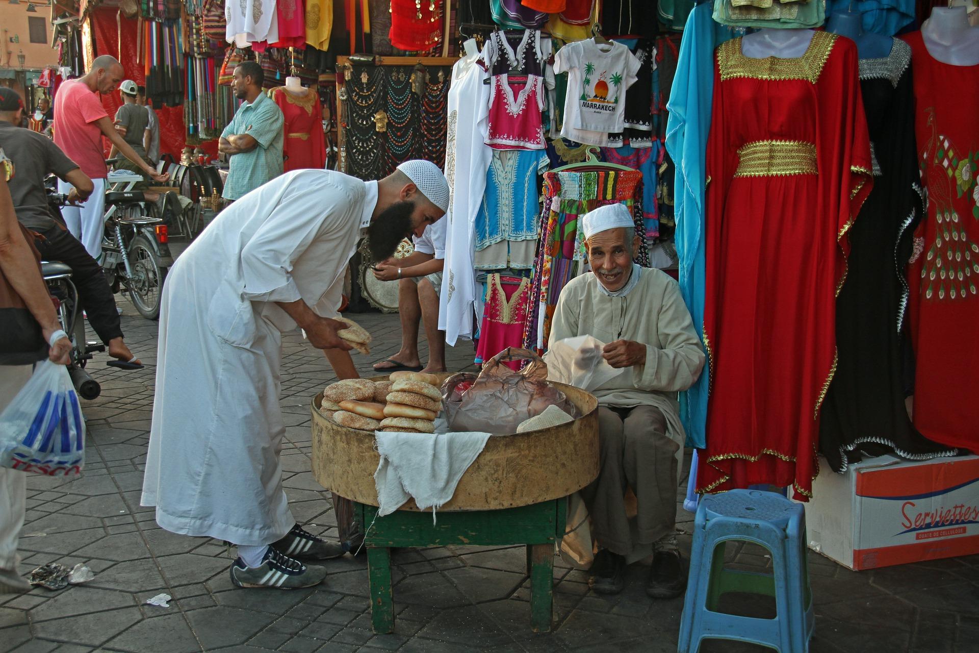 Arab men speaking to each other in market in Morocco