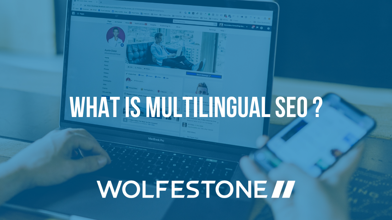 Image with the text: What is Multilingual? On top of an image of a computer, with a blue overlay and the Wolfestone logo