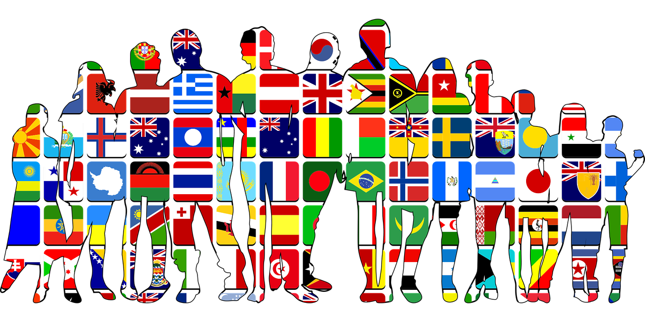 multiculturalism: silhouette of a group of people with the flags of the world in the silhoutte
