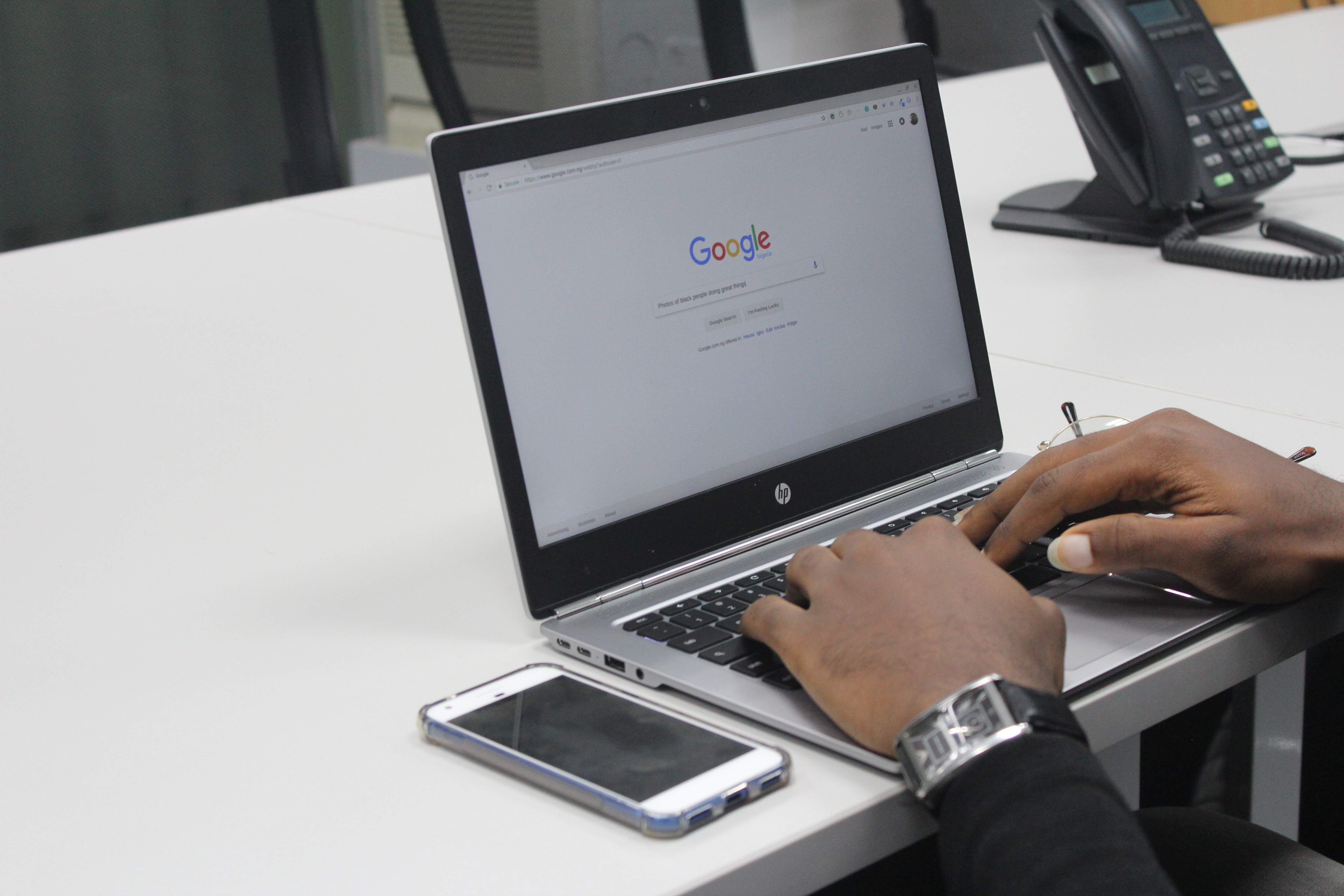 Person typing on Google.