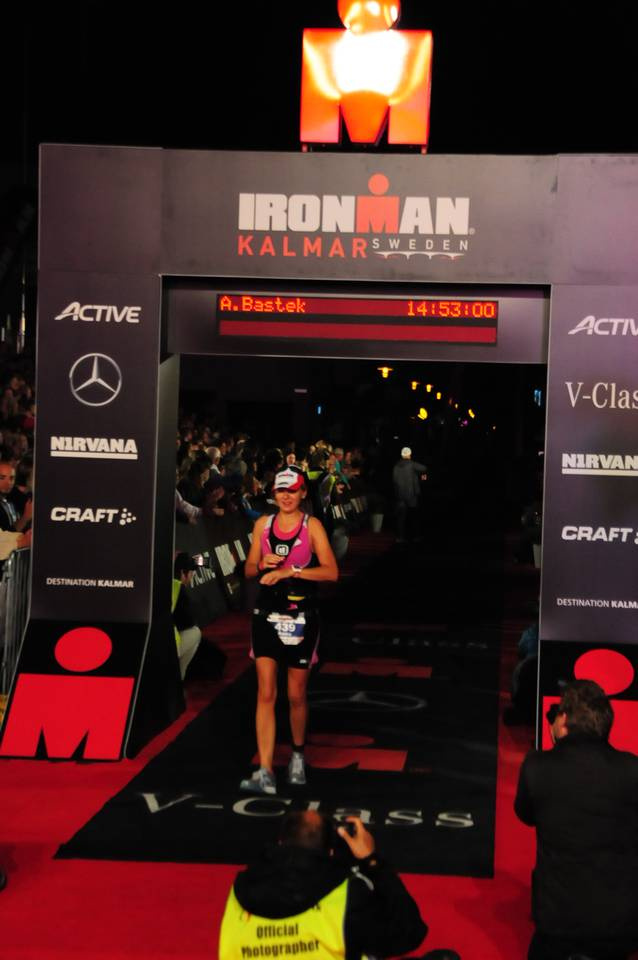 Anna Bastek crossing the finish line of the Ironman
