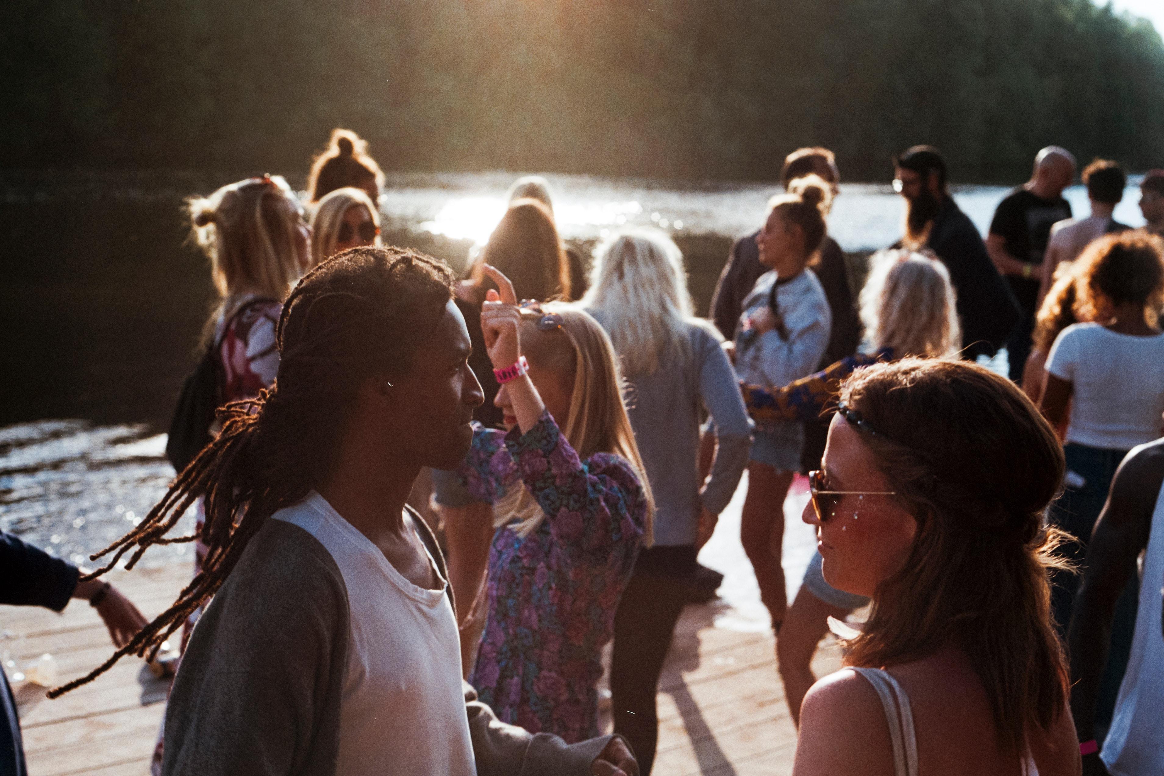 International youth gather beside a lake