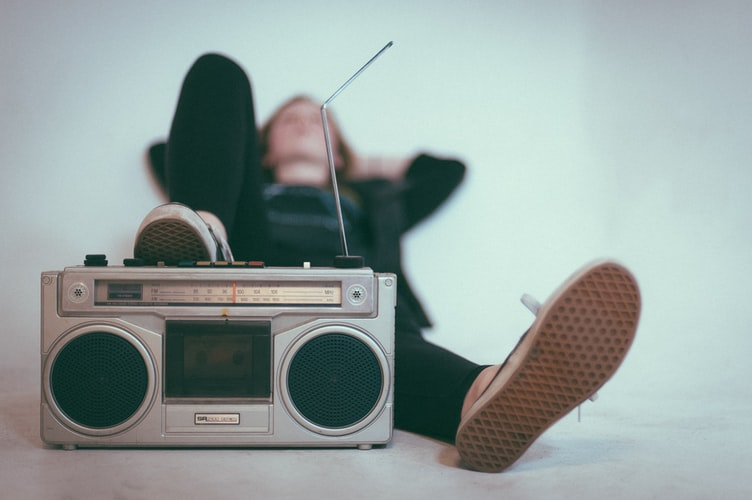 Woman lying with radio