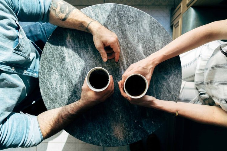 Two people drinking coffee