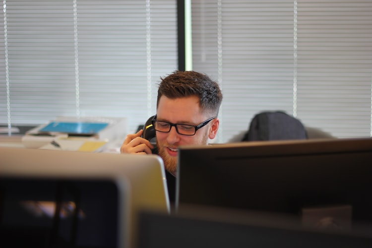 Man speaking on phone in office