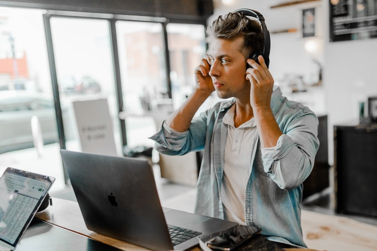 Remote working putting headphones on