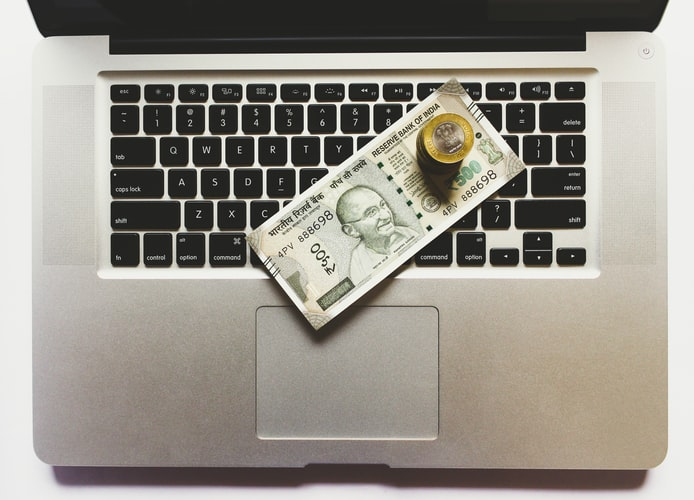 Laptop with currency on top