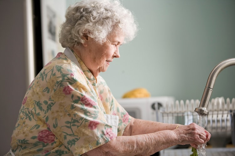 Older lady washing hands