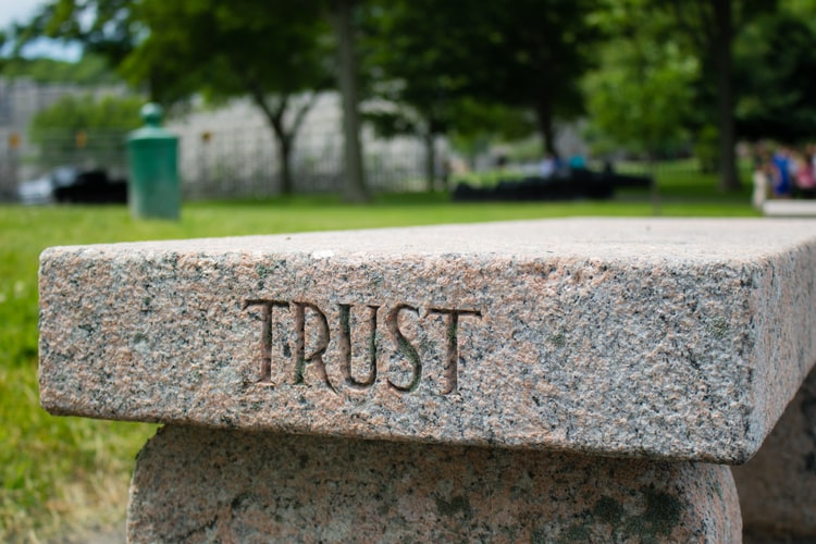 Bench with the word 'Trust' engraved