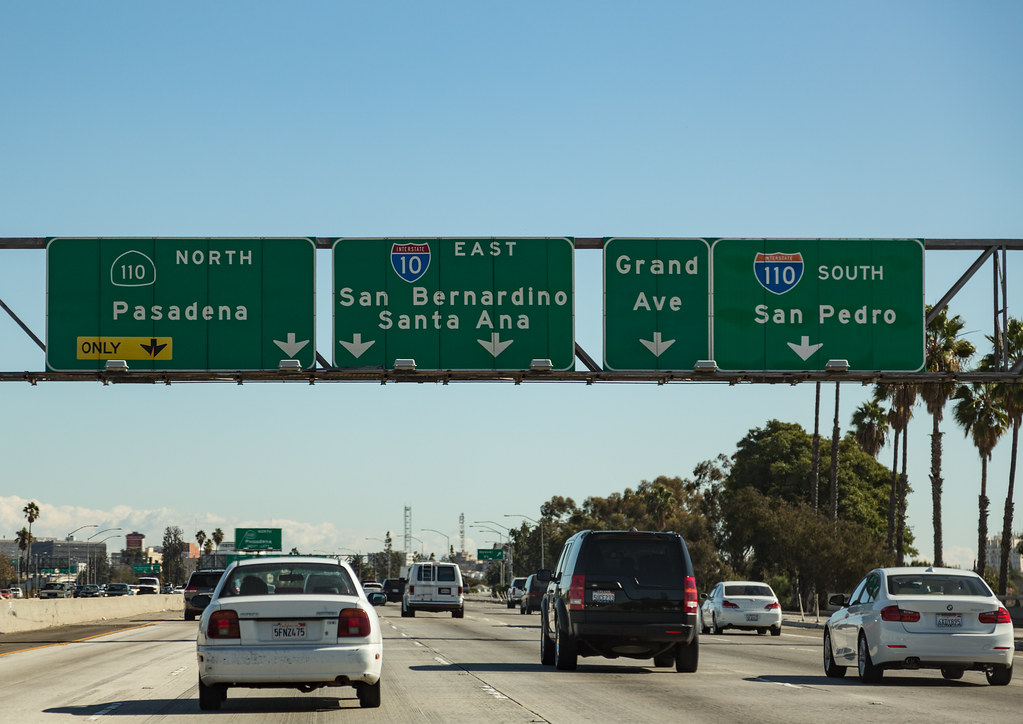 Road signs on a  US highway for cities with Spanish names